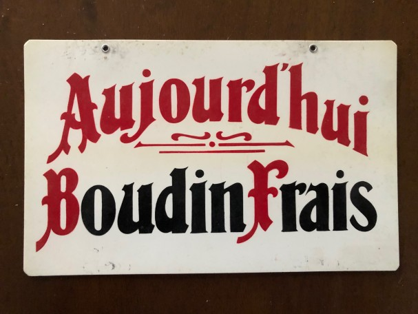 Panonceau publicitaire ancien.
